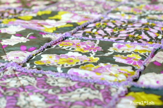 "The Rural*ish ""Sienna"" rag quilt is perfect for baby girls! Vintagey roses, groovy butterflies, delicate flowers, and leafy feathers come together beautifully in a modern palette of violets and lavenders, pinks, charcoal gray, olive and lime greens. www.ruralish.etsy.com"